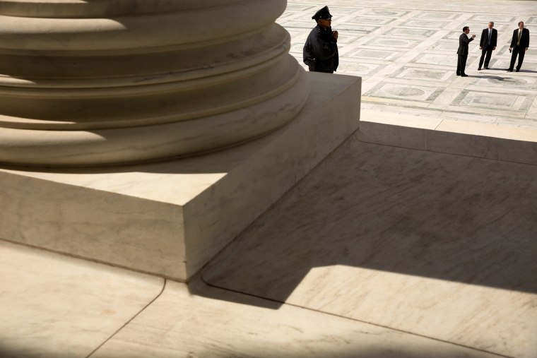 A guard stands on the steps of the U.S. Supreme Court building in Washington, Oct. 5, 2015. (Photo by Jonathan Ernst/Reuters)