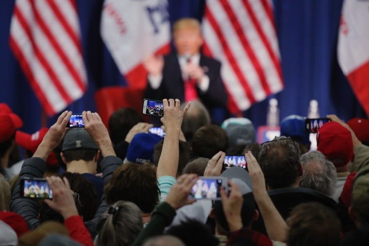 People photograph Republican presidential candidate Donald Trump with their smart phones as he speaks to guests during a campaign rally at the Gerald W. Kirn Middle School on Jan. 31, 2016 in Council Bluffs, Iowa. (Photo by Christopher Furlong/Getty)