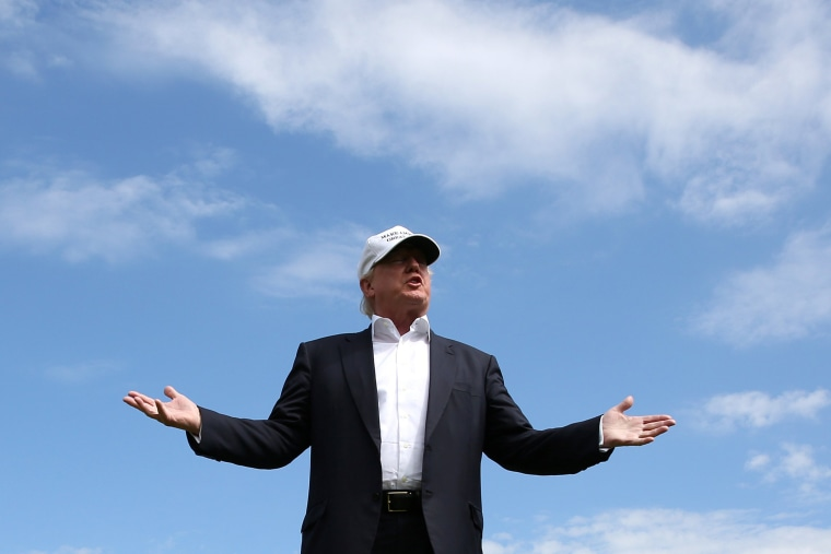 Republican presidential candidate Donald Trump speaks to the media on the golf course at his Trump International Golf Links in Aberdeen, Scotland, June 25, 2016. (Photo by Carlo Allegri/Reuters)