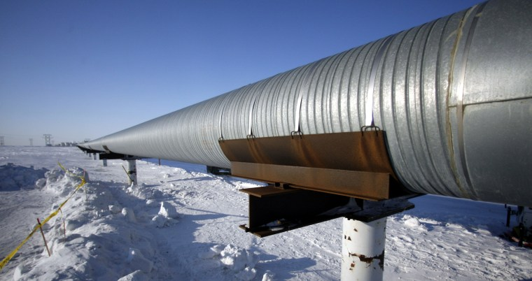 A pipeline in Prudhoe Bay oil field on Alaska's North Slope is seen Monday, March 13, 2006. (AP Photo/Rick Bowmer)