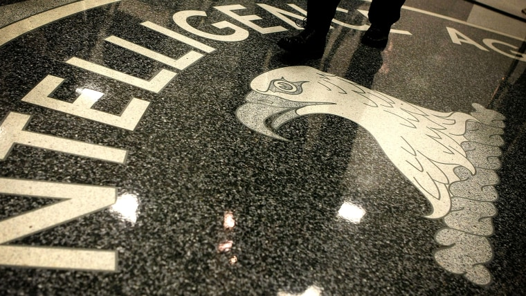 A man walks across the seal of the Central Intelligence Agency at the lobby of the Original Headquarters Building at the CIA headquarters on Feb. 19, 2009 in McLean, Va. (Photo by Alex Wong/Getty)