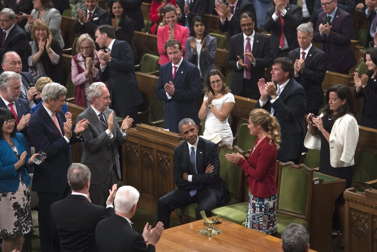 President Barack Obama receives a standing ovation in the House of Commons on Parliament Hill in Ottawa, Canada, June 29, 2016. (Photo by Adrian Wyld/The Canadian Press/AP)