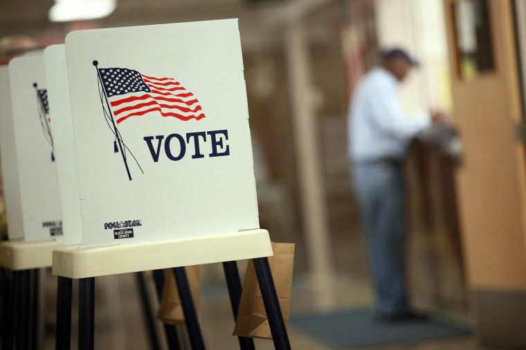 Voting booths are set up for early voting at the Black Hawk County Courthouse on September 27, 2012 in Waterloo, Iowa. (Photo by Scott Olson/Getty)