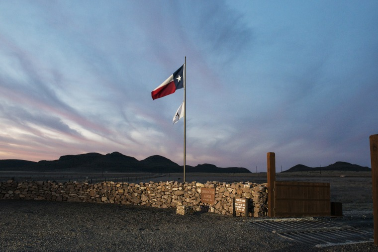 The Texas flag flies at the entrance to the Cibolo Creek Ranch in Shafter, Texas. (Photo by Matthew Busch/Getty)