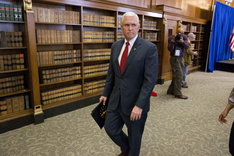 Indiana Gov. Mike Pence leaves a press conference March 31, 2015 at the Indiana State Library in Indianapolis, Indiana. (Photo by Aaron P. Bernstein/Getty)