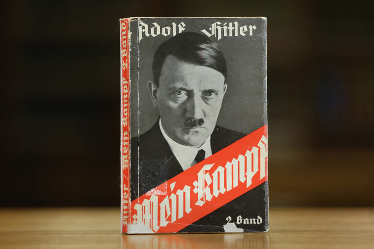 "A 1941 edition of Adolf Hitler's ""Mein Kampf"" stands at the library of the Deutsches Historisches Museum (German Historical Museum) on Dec. 15, 2015 in Berlin, Germany. Its copyright expired and has entered public domain. (Photo by Sean Gallup/Getty)"