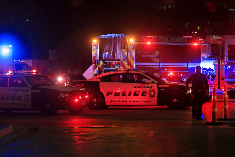 Dallas police work near the scene where eleven Dallas police officers were shot and five have now died on July 8, 2016 in Dallas, Texas. (Photo by Ron Jenkins/Getty)