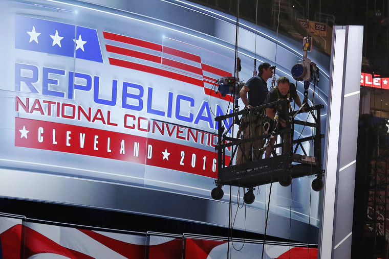 The main stage on the convention floor at the Quicken Loans Arena in downtown Cleveland, Ohio, is prepared for the upcoming RNC, as workers stand in a man lift, July 13, 2016. (Photo by Gene J. Puskar/AP)