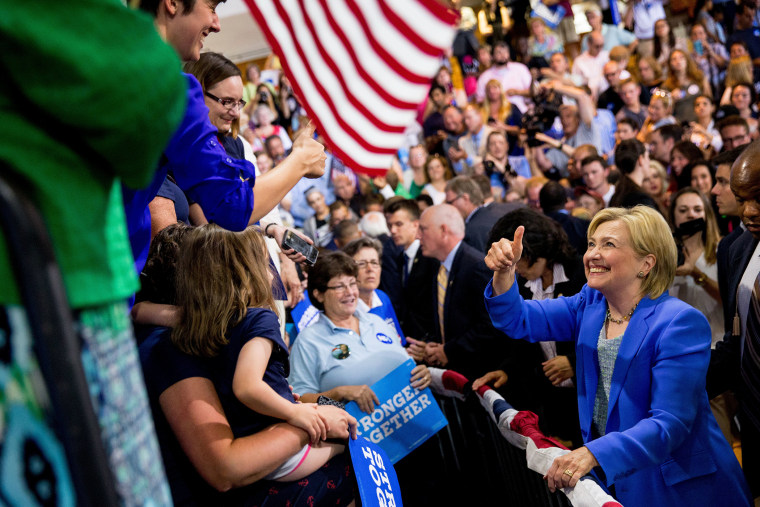 Democratic presidential candidate Hillary Clinton greets members of the audience during a rally in Portsmouth, N.H., July 12, 2016, where Sen. Bernie Sanders, I-Vt. endorsed Clinton for president.