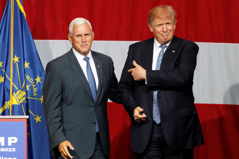 Republican presidential candidate Donald Trump and Indiana Governor Mike Pence wave to the crowd before addressing the crowd during a campaign stop at the Grand Park Events Center in Westfield, Indiana, July 12, 2016. (Photo by John Sommers II/Reuters)