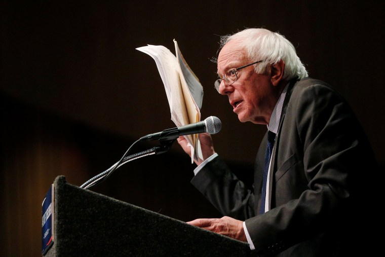 Democratic presidential candidate and Senator Bernie Sanders holds up his notes while speaking about his attempts to influence the Democratic party's platform during a speech in Albany, New York, June 24, 2016. (Photo by Bryan Snyder/Reuters)