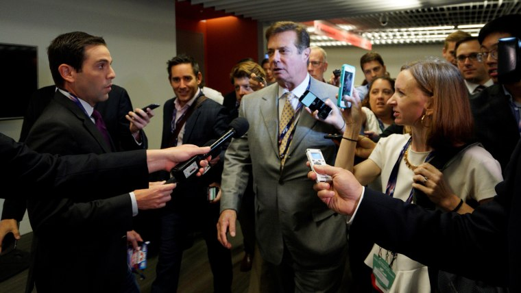 Paul Manafort, campaign manager to Republican Presidential Candidate Donald Trump, is surrounded by reporters in Cleveland, Ohio, July 14, 2016. (Photo by Rick Wilking/Reuters)