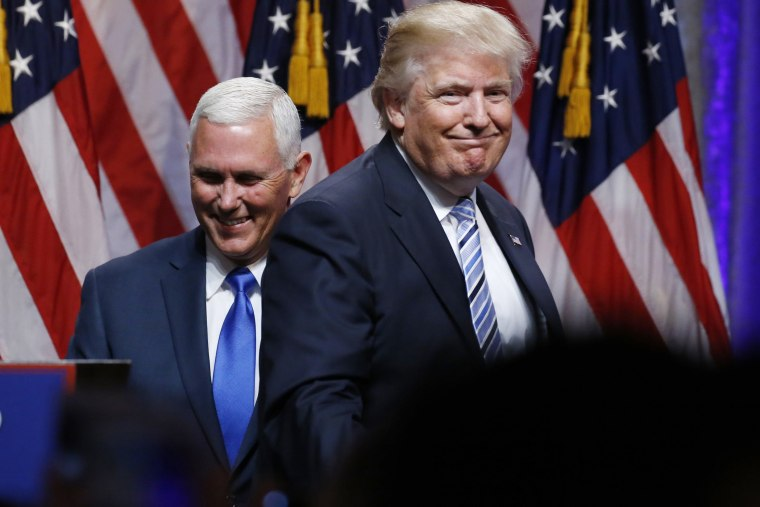 Republican U.S. presidential candidate Donald Trump steps away after greeting Indiana Governor Mike Pence during the introduction of Pence as his vice presidential running mate in New York City, July 16, 2016. (Photo by Carlo Allegri/Reuters)