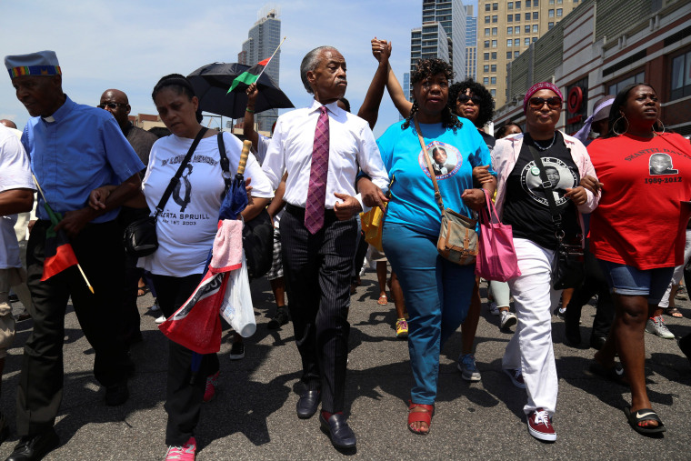 Rev. Al Sharpton and mother of police chokehold victim Eric Garner, Gwen Carr lead a march two years after his death in the Brooklyn borough of New York, July 16, 2016. (Photo by Bria Webb/Reuters)