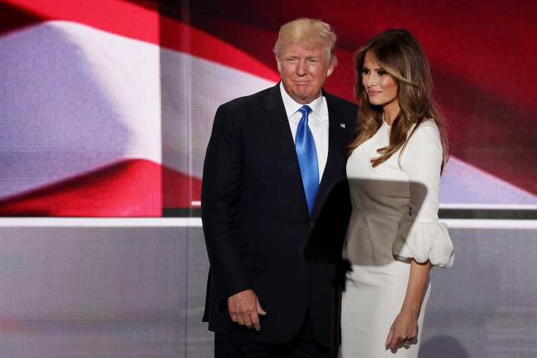 Donald Trump stands with his wife Melania after she delivered a speech on the first day of the Republican National Convention on July 18, 2016 at the Quicken Loans Arena in Cleveland, Ohio. (Photo by Alex Wong/Getty)