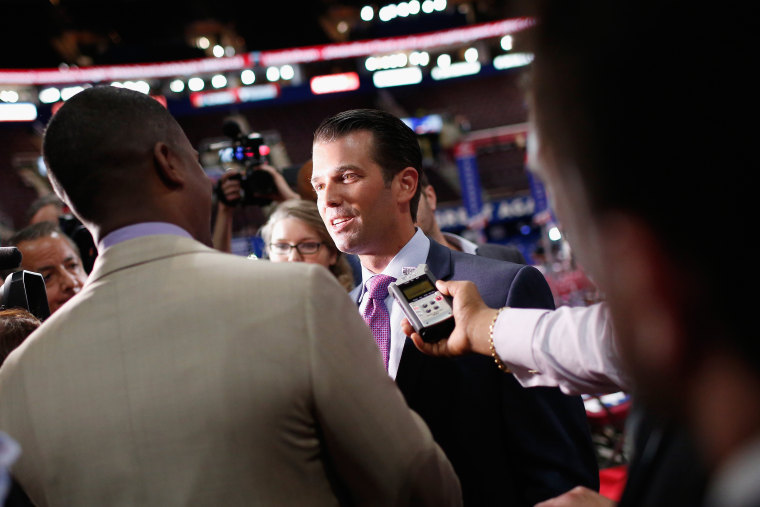 Donald Trump Jr. is interviewed by the media prior to the start of the second day of the Republican National Convention on July 19, 2016 at the Quicken Loans Arena in Cleveland, Ohio. (Photo by Win McNamee/Getty)