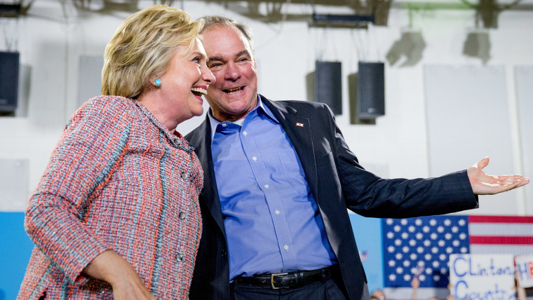 Democratic presidential candidate Hillary Clinton and Sen. Tim Kaine, D-Va.,participate in a rally at Northern Virginia Community College in Annandale, Va., July 14, 2016. (Photo by Andrew Harnik/AP)