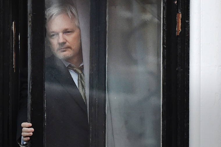 This file photo taken on Feb. 05, 2016 shows WikiLeaks founder Julian Assange coming out on the balcony of the Ecuadorian embassy to address the media in central London. (Photo by Ben Stansall/AFP/Getty)