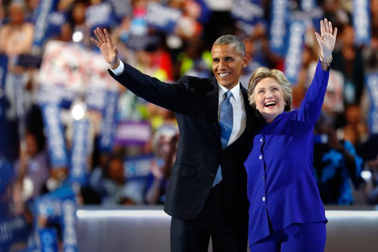 President Barack Obama and Democratic presidential candidate Hillary Clinton wave to the crowd at the Democratic National Convention, July 27, 2016 in Philadelphia, Penn. (Photo by Aaron P. Bernstein/Getty)