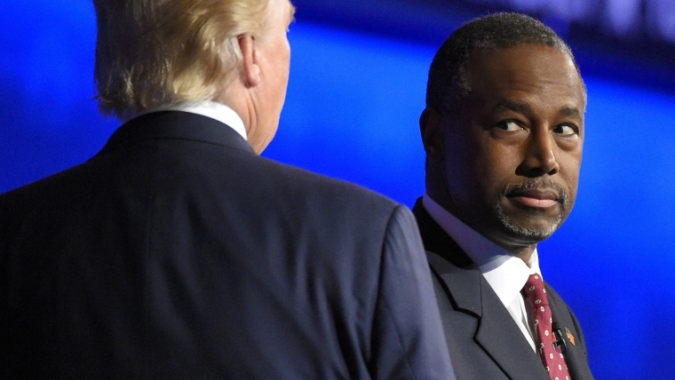 Ben Carson watches as Donald Trump takes the stage during the CNBC Republican presidential debate at the University of Colorado, Oct. 28, 2015, in Boulder, Colo. (Photo by Mark J. Terrill/AP)