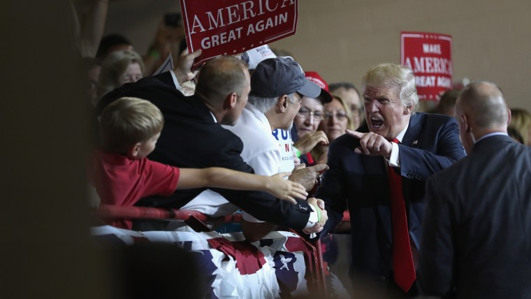 Republican Presidential nominee Donald Trump greets supporters after a campaign rally on Aug. 1, 2016 in Mechanicsburg, Pa. (Photo by John Moore/Getty)