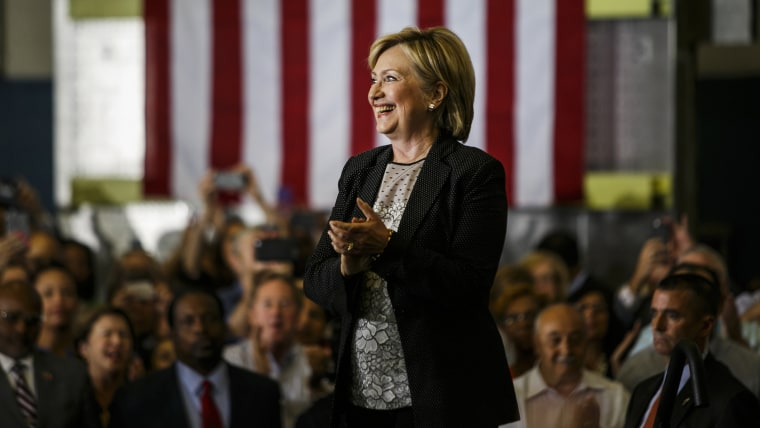 Hillary Clinton, 2016 Democratic presidential nominee, smiles before speaking during a campaign event in Warren, Mich., Aug. 11, 2016. (Photo by Sean Proctor/Bloomberg/Getty)