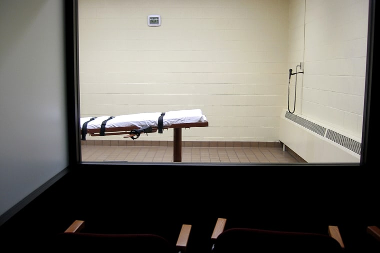 A witness room faces an execution chamber. (Photo by Caroline Groussain/AFP/Getty)