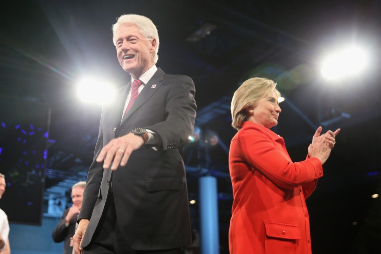 Democratic presidential candidate Hillary Clinton and her husband former president Bill Clinton greet guests at the end of the Jefferson-Jackson Dinner on Oct. 24, 2015 in Des Moines, Iowa. (Photo by Scott Olson/Getty)