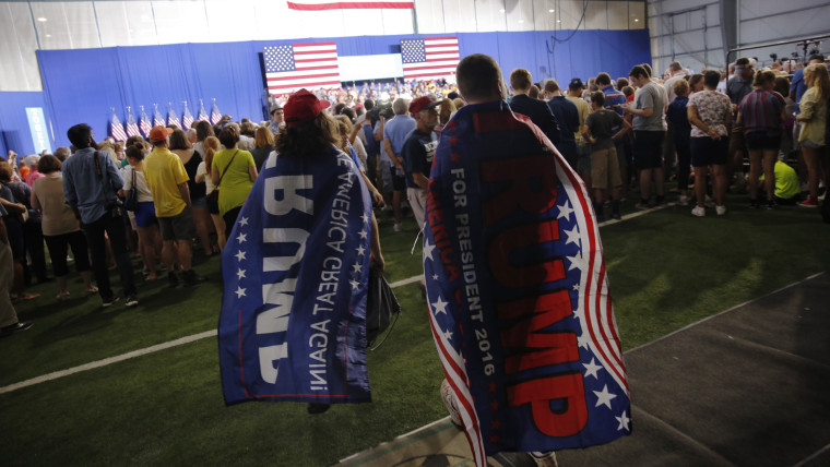 Supporters of Republican presidential nominee Donald Trump wear flag capes, Aug. 15, 2016, in Scranton, Pa. (Photo by Dominick Reuter/AFP/Getty)
