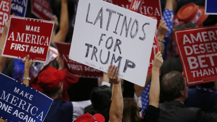 A person holds a sign reading 'Latinos for Trump' on the third day of the Republican National Convention in Cleveland, Ohio, July 20, 2016. (Photo by Carlo Allegri/Reuters)