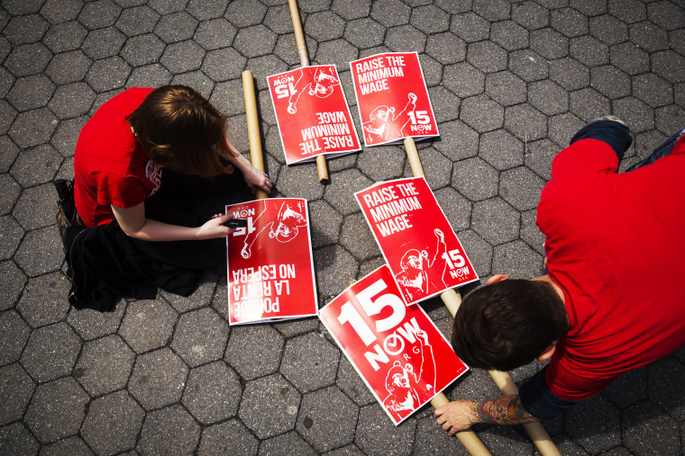 Demonstrators prepare signs supporting the raising of the federal minimum wage during May Day demonstrations, May 1, 2014, in New York. (Photo by Lucas Jackson/Reuters)