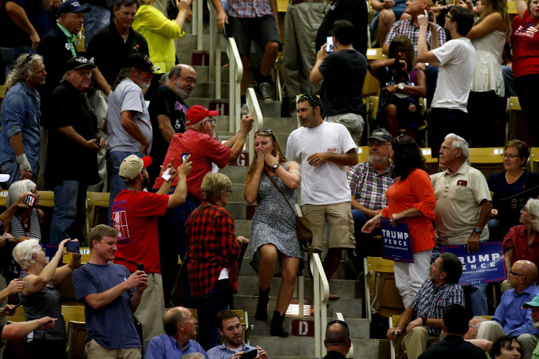 The crowd reacts as hecklers are escorted out during a speech by Republican presidential candidate Donald Trump at a rally on Sept. 12, 2016 at U.S. Cellular Center in Asheville, N.C. (Photo by Brian Blanco/Getty)