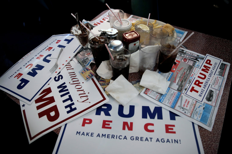 Signs for Republican presidential nominee Donald Trump are seen on a table during a Trump campaign stop at the Boulevard Diner in Dundalk, Md. on Sept. 12, 2016. (Photo by Mike Segar/Reuters)