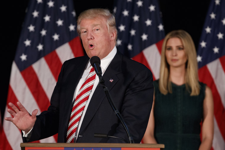 Ivanka Trump, right, listens as her father Republican presidential candidate Donald Trump delivers a policy speech on child care, Sept. 13, 2016, in Aston, Pa. (Photo by Evan Vucci/AP)