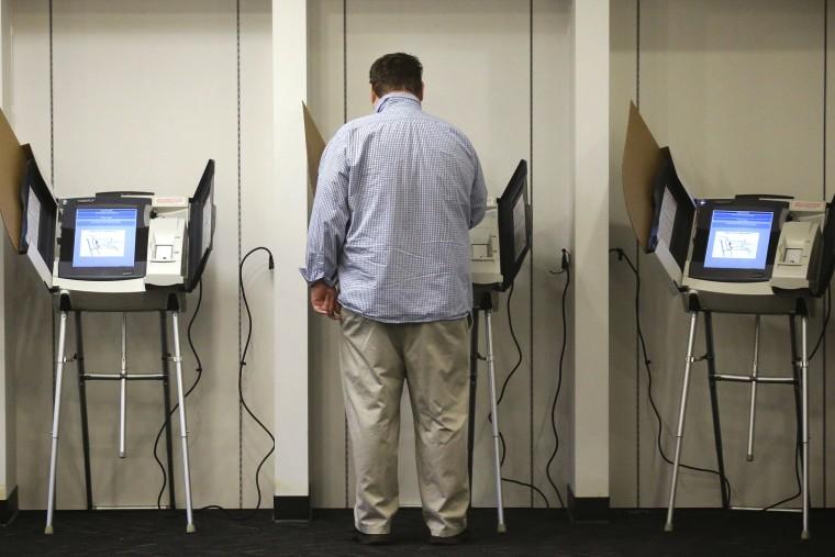 A man votes  in Salt Lake City, Utah. (Photo by Rick Bowmer/AP)