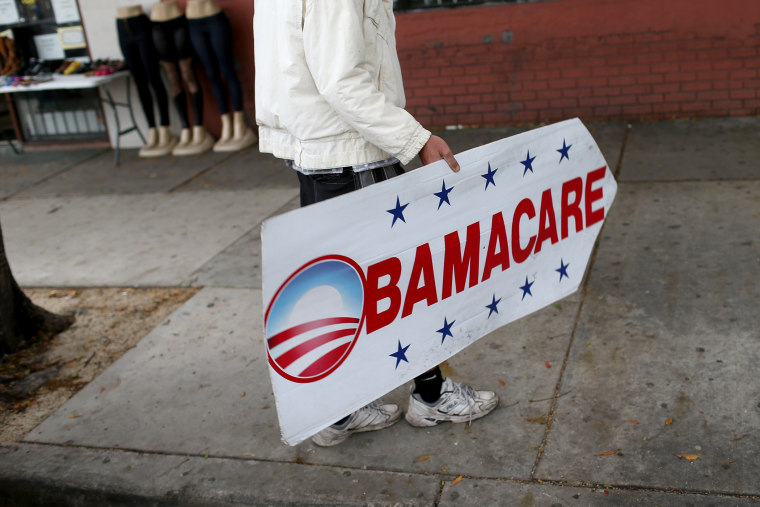 Pedro Rojas holds a sign directing people to an insurance company where they can sign up for the Affordable Care Act, also known as Obamacare, before the February 15th deadline on Feb. 5, 2015 in Miami, Fla.  (Joe Raedle/Getty)