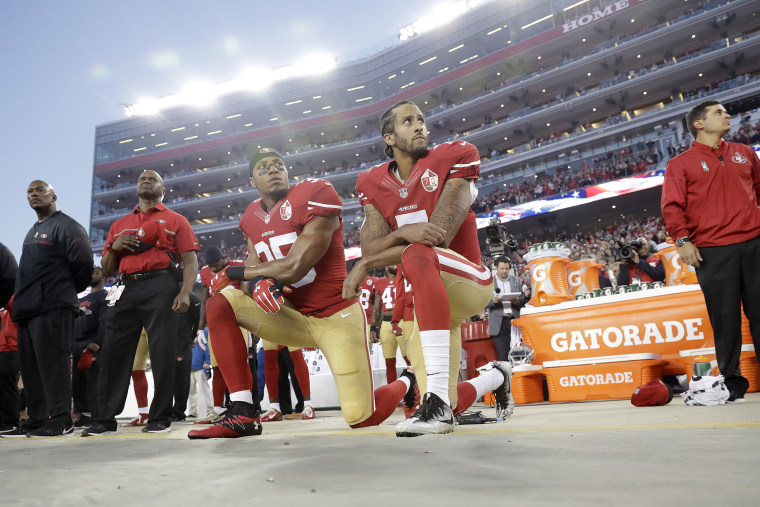 San Francisco 49ers safety Eric Reid (35) and quarterback Colin Kaepernick (7) kneel during the national anthem before an NFL football game against the Los Angeles Rams, Sept. 12, 2016, in Santa Clara, Calif. (Photo by Marcio Jose Sanchez/AP)
