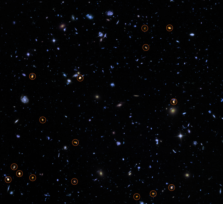 This image combines a background picture taken by the NASA/ESA Hubble Space Telescope (blue/green) with a new very deep ALMA view of this field (orange, marked with circles).
