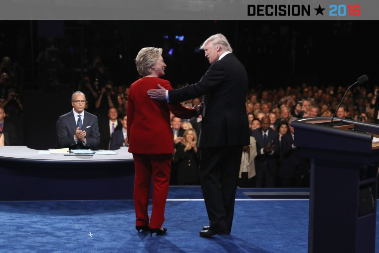 Democratic presidential nominee Hillary Clinton shakes hands with Republican presidential nominee Donald Trump during the Presidential Debate at Hofstra University on Sept. 26, 2016 in Hempstead, N.Y. (Photo by Joe Raedle/Getty)