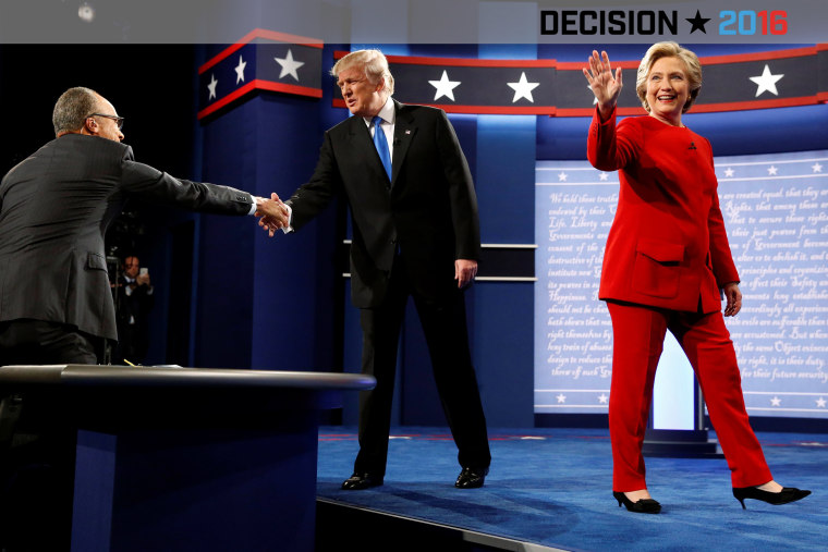 Republican U.S. presidential nominee Donald Trump and Democratic U.S. presidential nominee Hillary Clinton take the stage for their first debate at Hofstra University, Sept. 26, 2016 in Hempstead, N.Y. (Photo by Jonathan Ernst/Reuters)