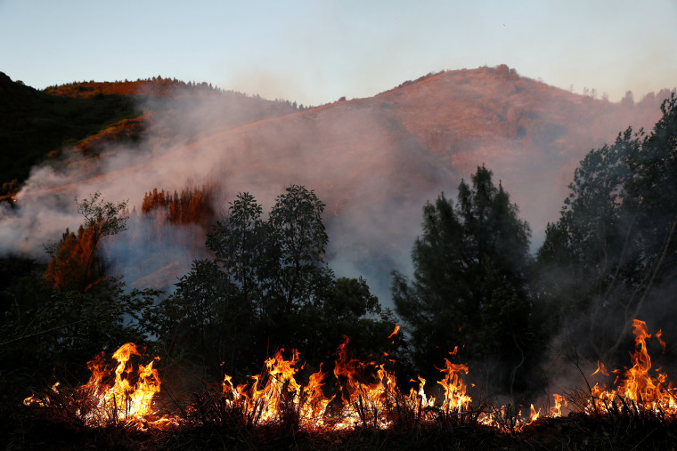 Smoke and flames are seen along Loma Prieta Avenue during the Loma Fire near Santa Cruz, Calif. on Sept. 27, 2016. (Photo by Stephen Lam/Reuters)