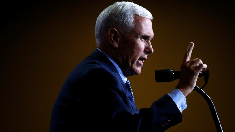 Republican vice presidential nominee Mike Pence speaks at a campaign rally in Phoenix, Ariz., on Aug. 31, 2016. (Photo by Carlo Allegri/Reuters)