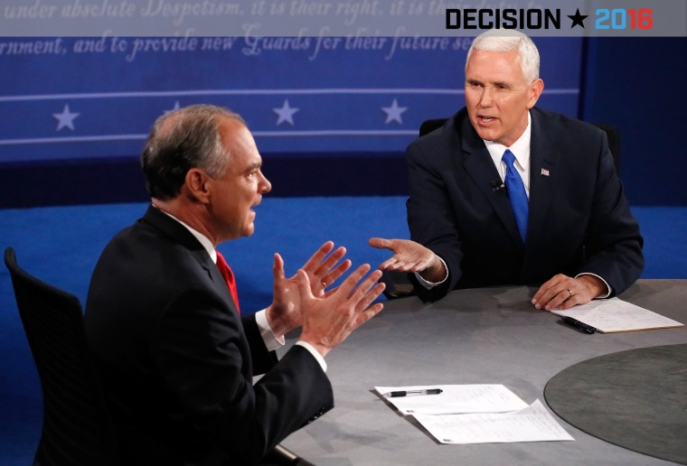 Democratic vice presidential nominee Tim Kaine  and Republican vice presidential nominee Mike Pence speak during the Vice Presidential Debate at Longwood University on Oct. 4, 2016 in Farmville, Va. (Photo by Andrew Gombert/Pool/Getty)