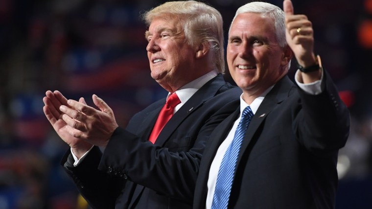 Republican Presidential candidate Donald Trump and Republican Vice Presidential candidate Mike Pence celebrate, during the final day of the Republican National Convention on July 21, 2016. (Photo by Jabin Botsford/The Washington Post/Getty)