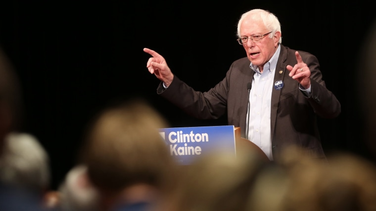 Sen. Bernie Sanders, I-Vt., speaks to a crowd as he campaigns for Democratic presidential candidate Hillary Clinton at Monona Terrace Community and Convention Center, Oct. 5, 2016, in Madison, Wis. (Photo by Amber Arnold/Wisconsin State Journal/AP)