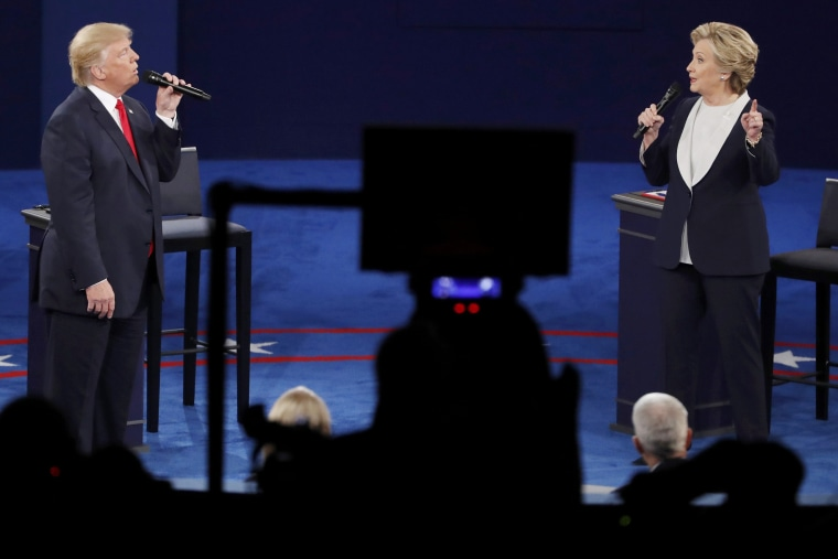 Republican presidential nominee Donald Trump and Democratic presidential nominee Hillary Clinton speak during their presidential town hall debate at Washington University, Oct. 9, 2016, in St. Louis, Mo. (Photo by Aaron P. Bernstein/Reuters)