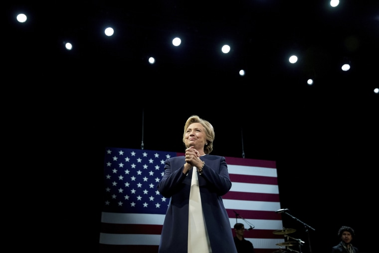 Democratic presidential candidate Hillary Clinton takes the stage at a fundraiser at the Civic Center Auditorium in San Francisco, Calif., Oct. 13, 2016. (Photo by Andrew Harnik/AP)