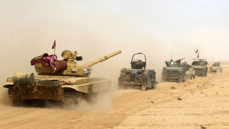 Iraqi forces deploy on Oct. 17, 2016 in the area of al-Shurah, some 45 kms south of Mosul, as they advance towards the city to retake it from the Islamic State group. (Photo by Ahmad Al-Rubaye/AFP/Getty)