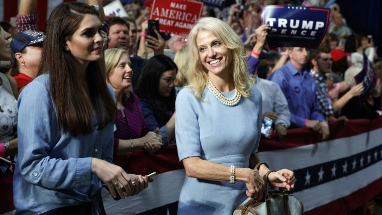 Kellyanne Conway, campaign manager for Republican presidential candidate Donald Trump, right, and press secretary Hope Hicks watch during a campaign rally on Oct. 14, 2016, in Charlotte, N.C. (Photo by Evan Vucci/AP)