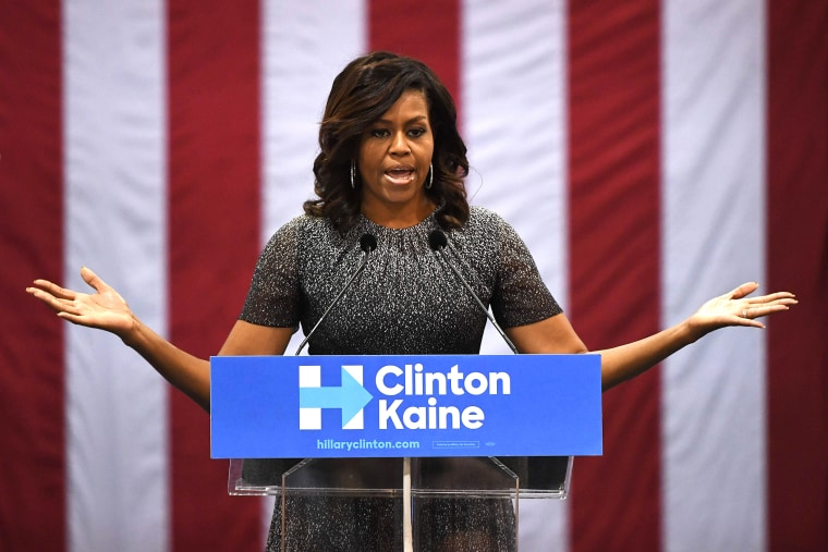 First Lady Michelle Obama speaks to a crowd of supporters as she campaigns for the Democratic Party presidential nominee Hillary Clinton at the Convention Center, in Phoenix, Ariz., on Oct. 20, 2016. (Photo by Mark Ralston/AFP/Getty)